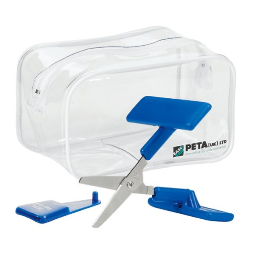 Image is a photograph of the rounded-tip push-down scissors on a white background, with blade shield and transparent, plastic carry bag behind the scissors.