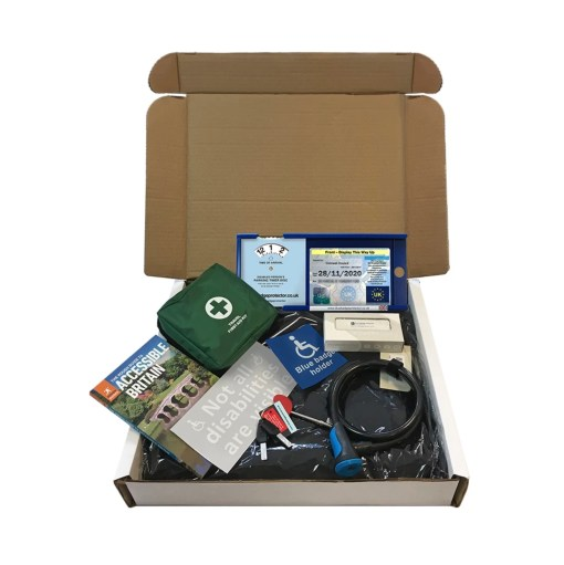 Image is a photograph of all parts of the disabled driver gift set, displayed in an open, white cardboard box