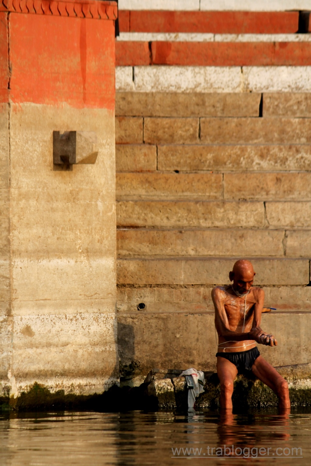 A man taking a bath at Varanasi