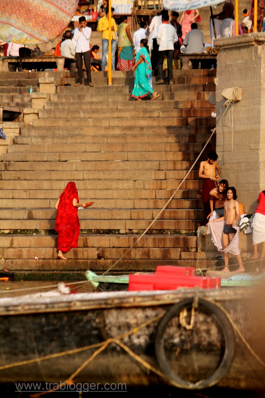 Woman Climbing the ghats after a dip in the Ganges
