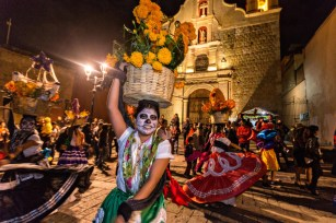 E9T6HP Costumed dancers at a Comparsa, or parade during the Day of the Dead Festival known in spanish as D?a de Muertos on October 31, 2014 in Oaxaca, Mexico.