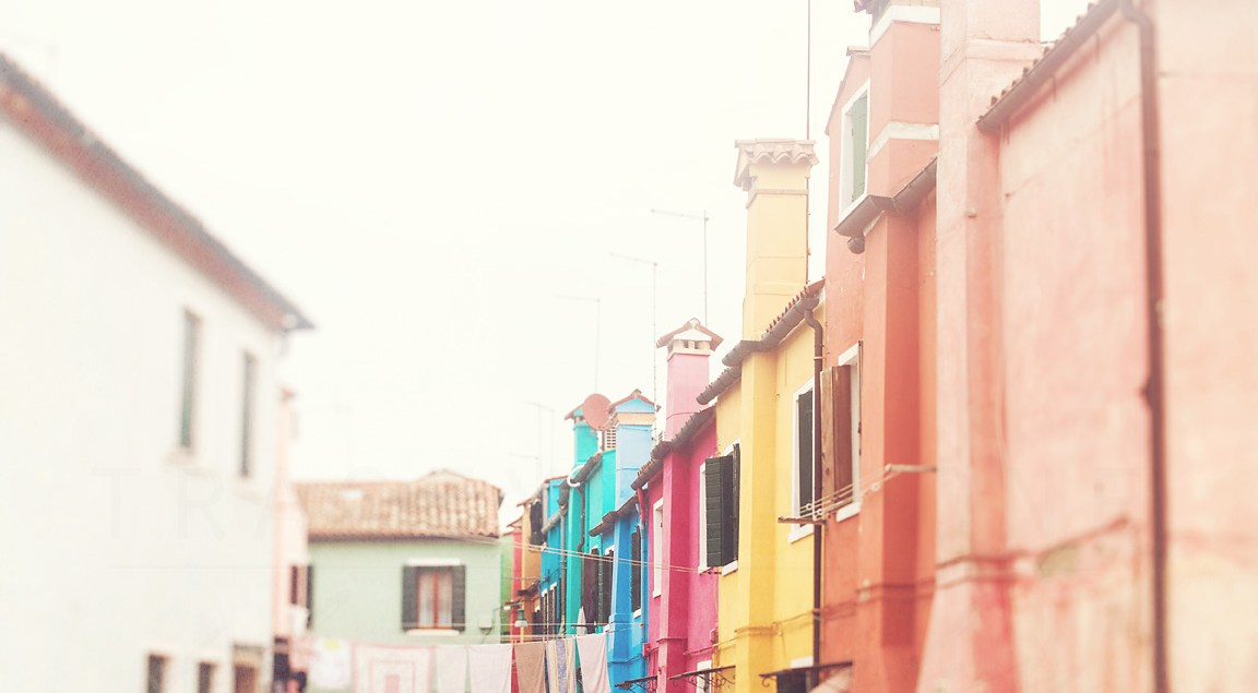 A row of colorful homes on the island of Burano, near Venice. Travel and architecture photography by Tracey Capone