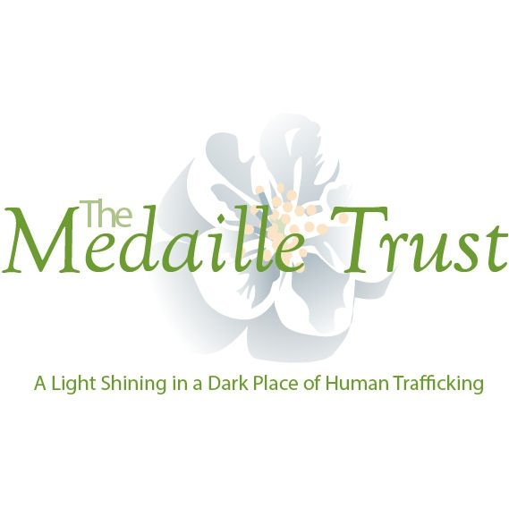 The Medaille Trust logo