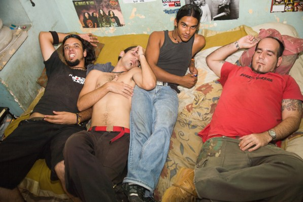 Members of Escape on Alejandro's bed.
