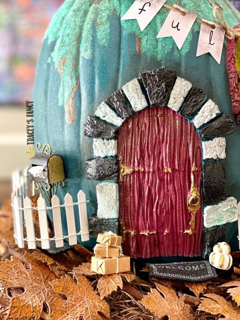 Whimsical DIY fairy house topiary using recycled pumpkins by Tracey's Fancy