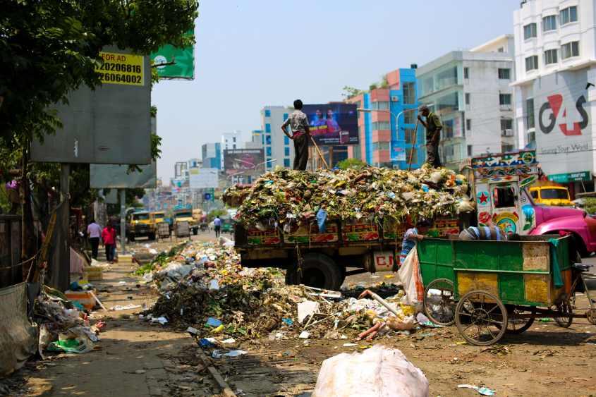 photo-of-a-dump-truck-across-buildings-2382894
