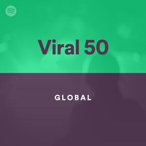 """Capa do sistema de chart """"Spotify Viral 50"""", que coleta dados mundiais de streaming. É uma capa minimalista, com as cores verde e roxa."""