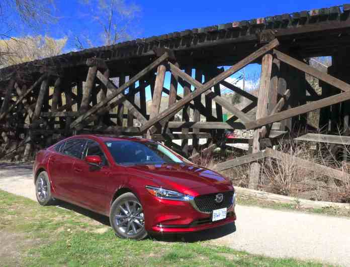2018 mazda6 review front sideview red