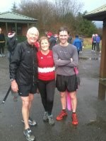 Wet and muddy with our new running buddy John
