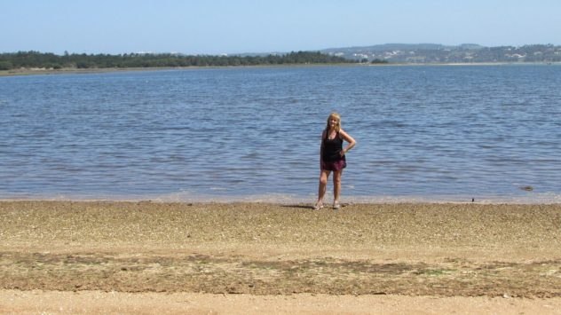 Tracy Burton stands on the pebble beach at the top of the Obidos lagoon near Caldas da Rainha