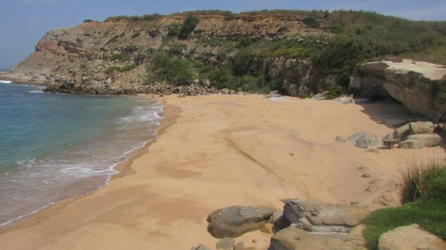 Secluded beach with ladder-only access on Silver Coast, midway between Peniche and Porto Novo, Silver Coast, Portugal