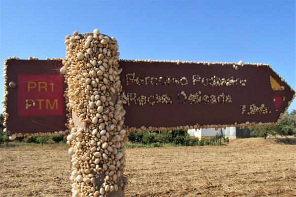 Snail-covered signpost, A Rocha Delicada, Mexilhoeira Grande, Algarve, Portugal