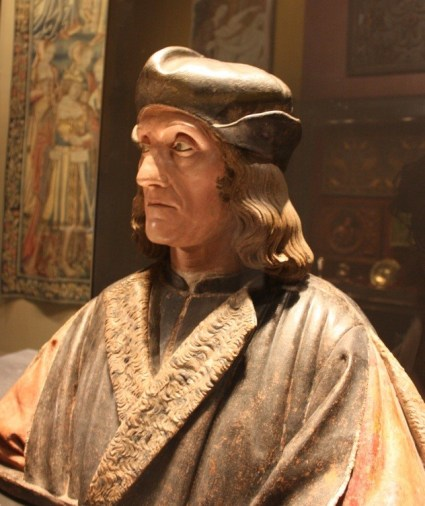 Henry VII.  Notice that his clothing looks quite medieval.  Henry was the first king to rule *after* the end of the medieval period.  By the time the Tudor Dynasty ended, the clothing was very different indeed.