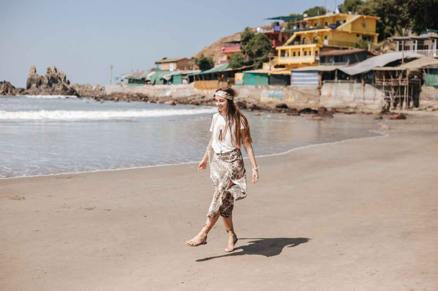 a beautiful woman walking on the beach