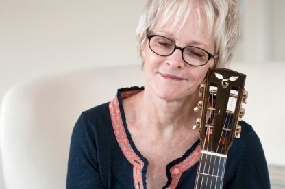 Photo of Tracy Newman and her Beloved Goodall Guitar