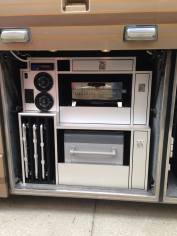 Custom-built entertainment bay loaded with a pull-out refrigerator/freezer, pull-out grill, bay radio and more!