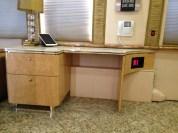 Custom-built salon workstation with a custom-cut Corian countertop.