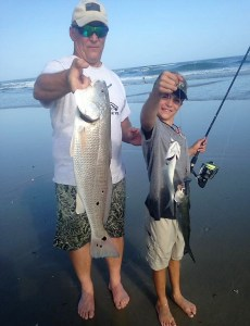 dr scott schroeder nad son with puppy drum and bluefish