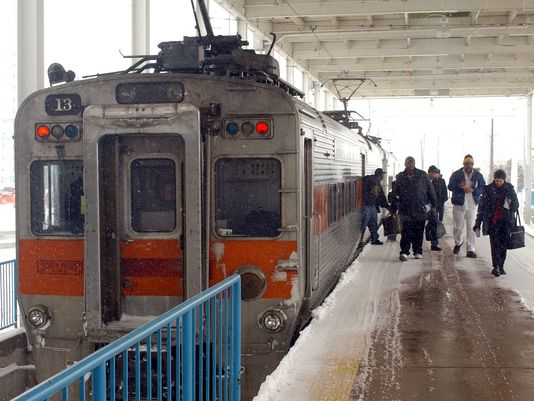 Passengers emerge from a South Shore train at South Bend Regional Airport.