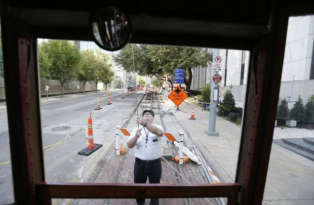 "M-Line trolley motorman Leo Tresp switched the end of the cable on the ""Green Dragon"" streetcar at the route's southern terminus downtown last month. A streetcar link between the Uptown trolley service and the Bishop Arts District is part of DART's expansion plan."