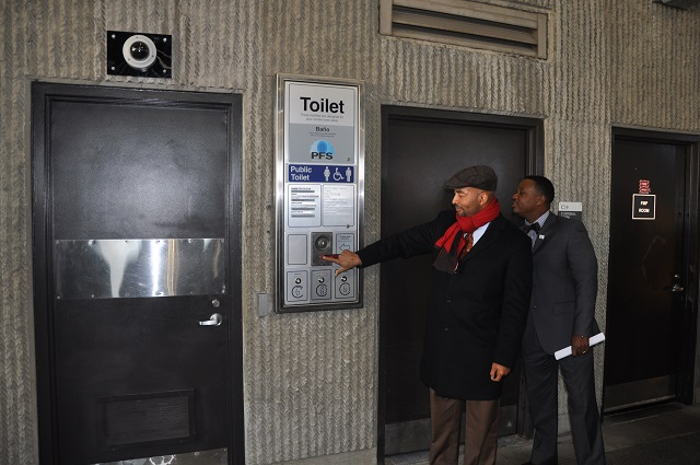 MARTA CEO Keith Parker shows off a state of the art bathroom system at the Lindbergh Center Station.                                  Photo by Dan Whisenhunt