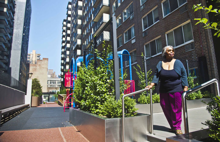 On Aug. 5, Jean Green Dorsey walks outside the building on New York City's Upper West Side where she has lived since 1972. Dorsey has a rent stabilized unit in a building that also houses market rate residents. As a rent stabilized tenant, Dorsey is not allowed to use the new gym that market rate residents use for free, even if she paid for the privilege.