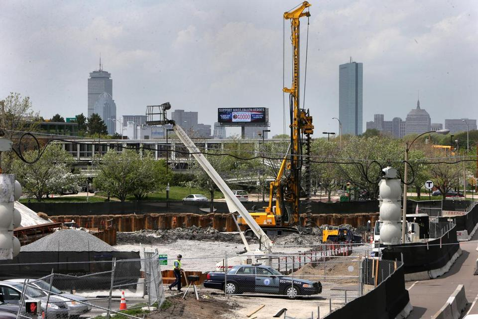 More than 275 apartments are under construction next to the JFK/UMass station. BARRY CHIN/GLOBE STAFF