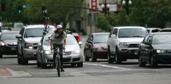(Francisco Kjolseth | Tribune file photo) Bicyclists make their way through Salt Lake City traffic. Officials are pushing to promote more walking and biking as the Wasatch Front population is predicted to double in coming decades.