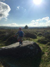 Boy climbing on rocks