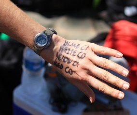 Francesca Bissman reminders on how to run the course written on her hand