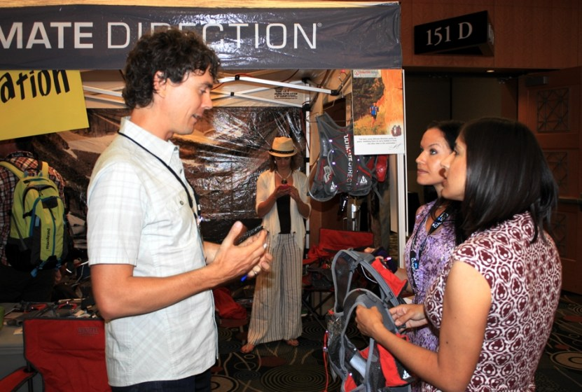 picture of scott jurek, yamilet nieto and andrea martinez at the ultimate direction booth