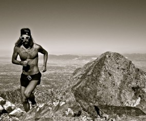 picture of Anton Tony Krupicka summiting twin peaks in salt lake city