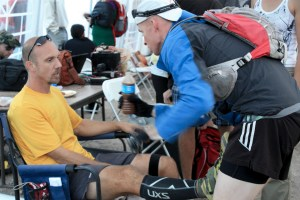 picture of mark kreuzer at the wasatch 100 getting support from his crew