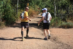 picture of mark kreuzer and jason drubert taking off from big mountain aid station at the wasatch 100