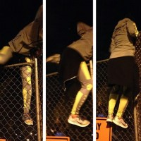 Robin Arzon Scaling a fence on a run in New York City