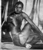 "NBA All-Star Kareem Abdul-Jabbar demonstrates ""spine twist""."
