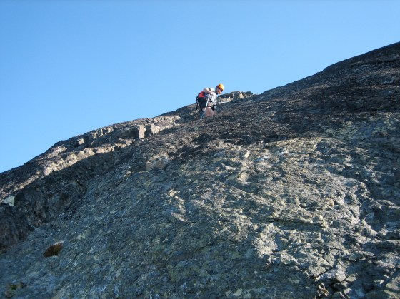 Kevin Rappelling Off Mt Clark Summit