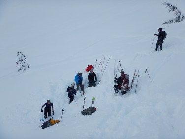 Search teams digging for the 3rd buried beacon and Scott waiting nearby for his acting debut as a broken back injury