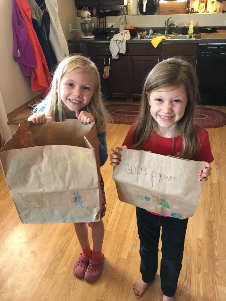 Trail girls showing their decorated paper bags