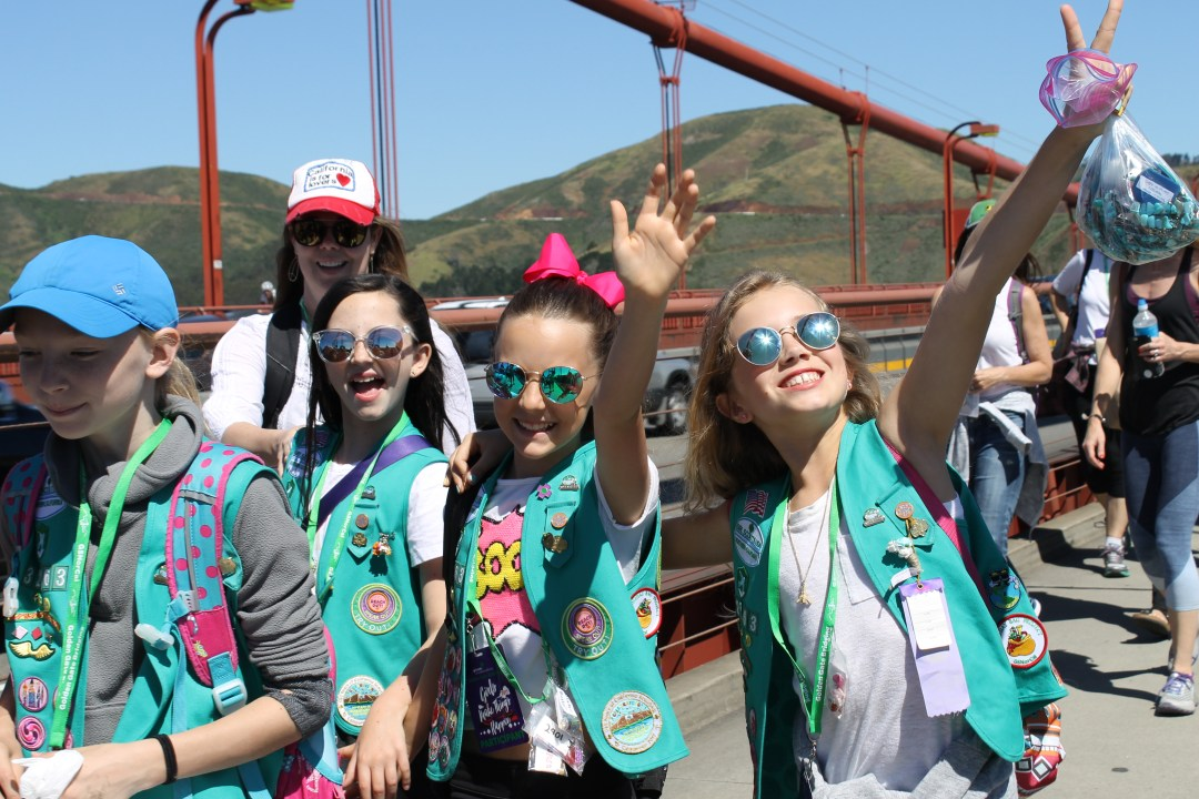Girl Scouts crossing the Golden Gate Bridge in sunglasses