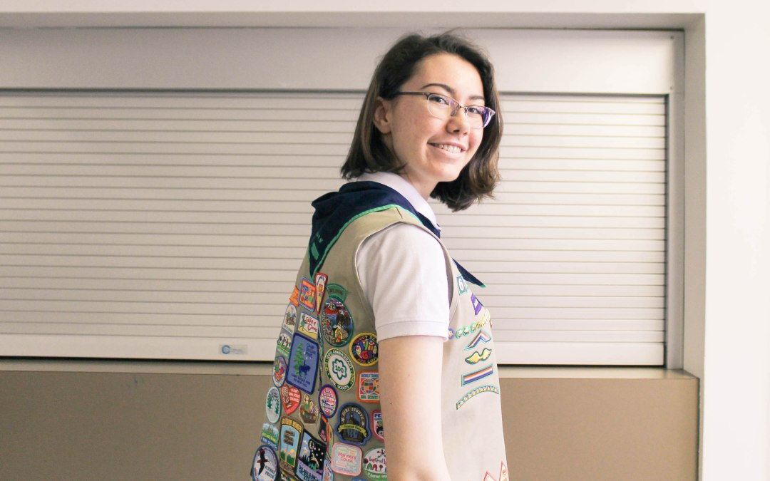 Girl with vest covered in fun patches