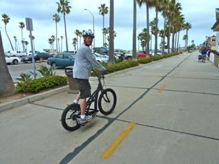 trailsnet lead writer tries out a 3G Stepper personal transportation vehicle on California's Huntington Beach Trail.