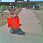 cyclists must dismount sign at construction site