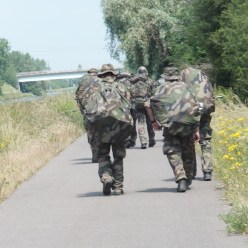 French soldiers march on the Moselle River Trail in France.