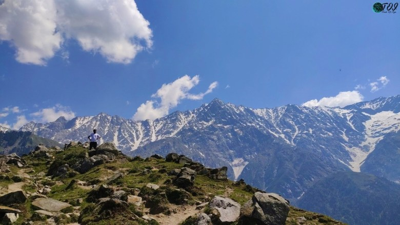 A tiny human in front of Dhauladhar Mountains