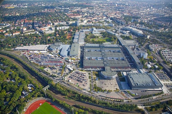 An arial view of the InnoTrans exhibition area. Notice the outdoor exhibition area in the left middle of the photograph full of rolling stock. The main rail line can be seen arching from the bottom right to the middle left of the picture. Downtown Berlin is relatively close by to the right.  Photograph: Berlin Messe GmbH