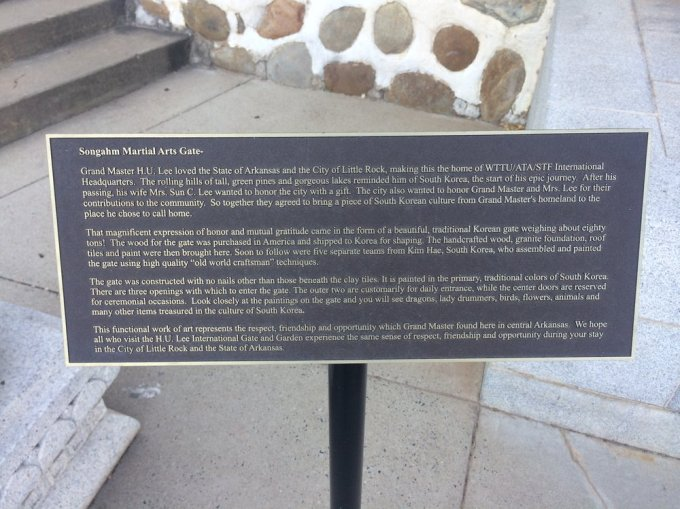 A plaque in near a Korean arch in downtown Little Rock.  Behind it is a tranquil Korean style garden.     Photo by B. WIng