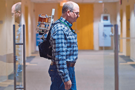 engineer wears a prototype POINTER