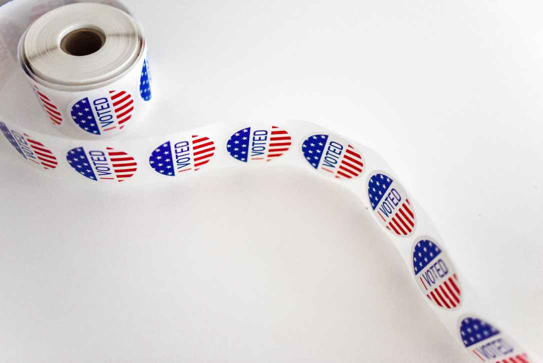 i voted sticker spool on white surface