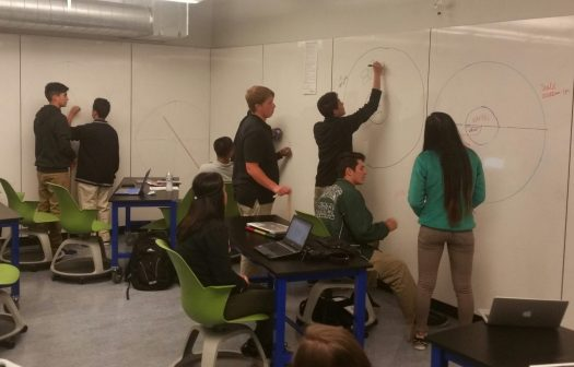 students creating scale models of GPS satellite orbits